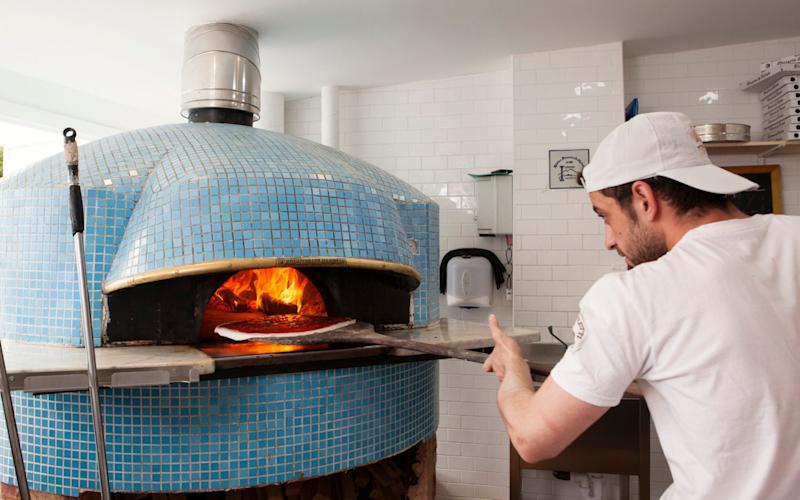 Sunday Telegraph Restaurant Review: L'Antica Pizzeria da Michele in Stoke Newington, London, UK. Making pizza. 07 April 2017 - Credit: Rii Schroer for The Telegraph