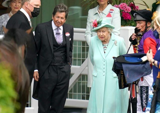 Queen Elizabeth II with racing manager John Warren, second left, and jockey Frankie Dettori, right, inspect horse Reach For The Moon at Royal Ascot