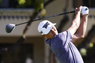 James Hahn tees off on the fifth hole during the final round of a PGA golf tournament on Sunday, Feb. 7, 2021, in Scottsdale, Ariz. (AP Photo/Rick Scuteri)