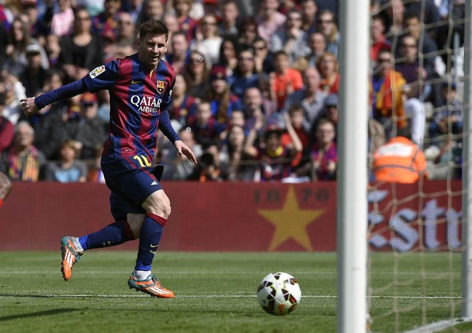 Barcelona's Argentinian forward Lionel Messi scores a goal during the Spanish league match against Rayo Vallecano de Madrid at the Camp Nou stadium in Barcelona on March 8, 2015 (AFP Photo/Lluis Gene)