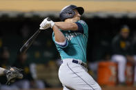 Seattle Mariners' Kyle Seager hits a two-run double against the Oakland Athletics during the third inning of a baseball game in Oakland, Calif., Monday, Sept. 20, 2021. (AP Photo/Jeff Chiu)