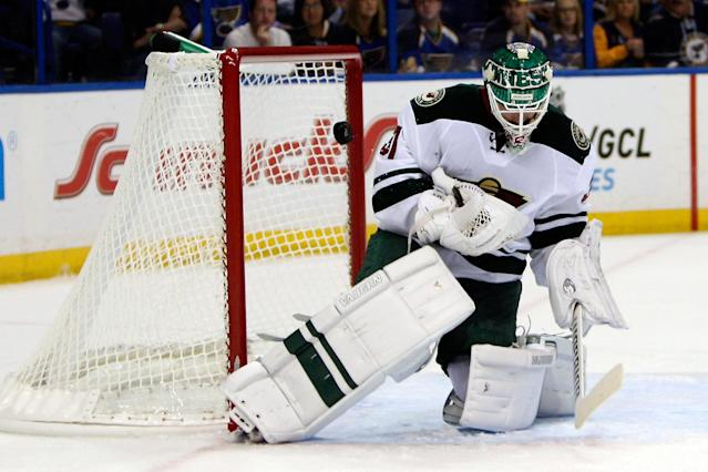 Minnesota Wild goalie Josh Harding deflects a shot on goal during the second period of a preseason NHL hockey game against the St. Louis Blues Friday, Sept. 27, 2013, in St. Louis. (AP Photo/Scott Kane)