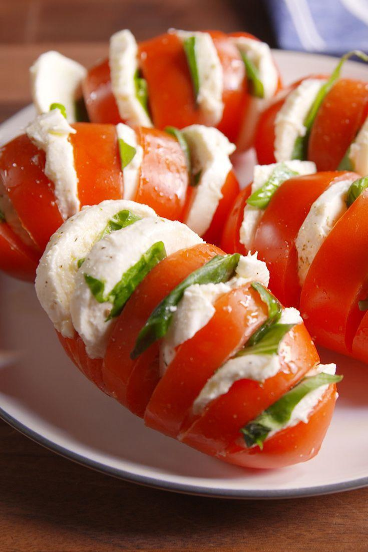 """<p>Class up tomato-and-mozz salad with this hasselback technique.</p><p>Get the recipe from <a href=""""https://www.delish.com/cooking/recipe-ideas/recipes/a48697/caprese-tomatoes-recipe/"""" rel=""""nofollow noopener"""" target=""""_blank"""" data-ylk=""""slk:Delish"""" class=""""link rapid-noclick-resp"""">Delish</a>.</p>"""