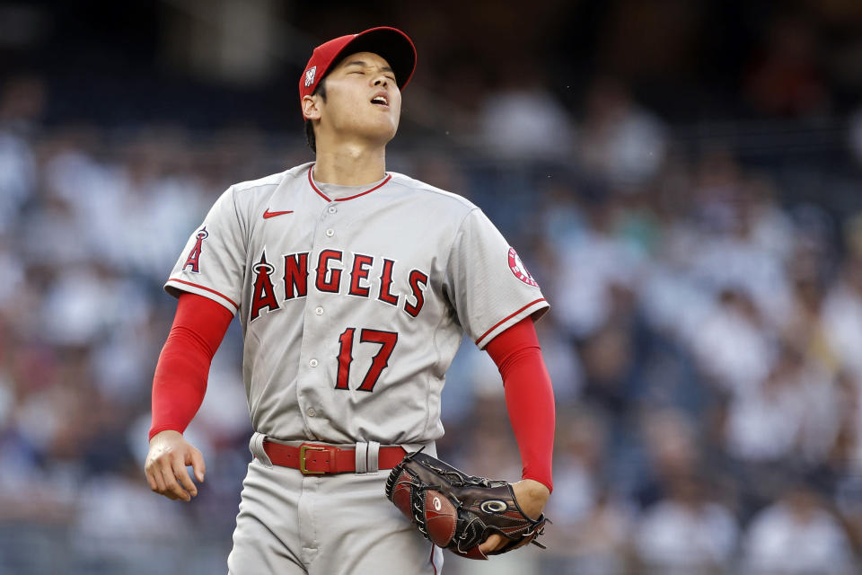 Los Angeles Angels pitcher Shohei Ohtani reacts during the first inning of the team's baseball game against the New York Yankees on Wednesday, June 30, 2021, in New York. (AP Photo/Adam Hunger)
