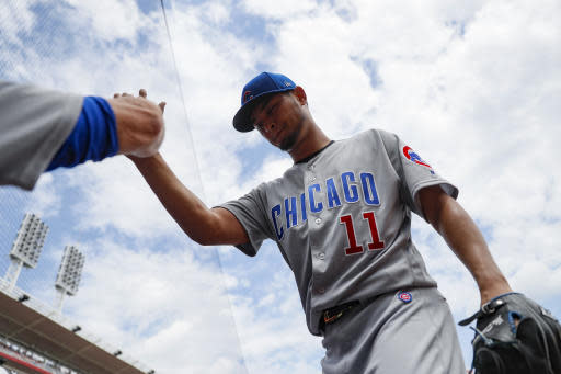 Chicago Cubs starting pitcher Yu Darvish (11) celebrates after closing the sixth inning of a baseball game against the Cincinnati Reds, Sunday, May 20, 2018, in Cincinnati. (AP Photo/John Minchillo)