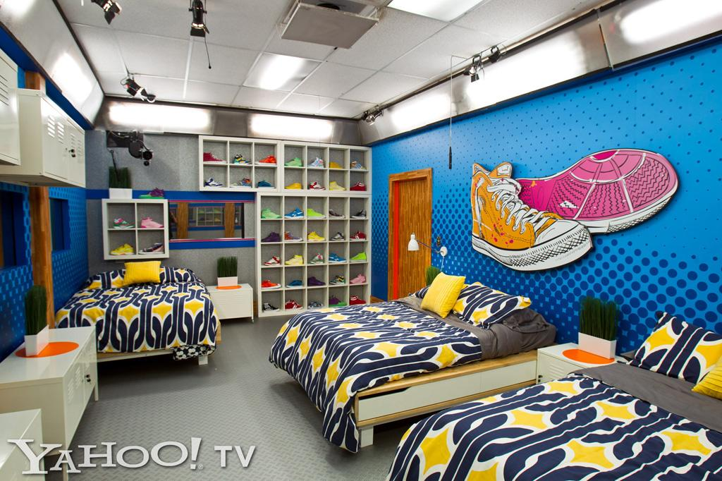 "<span style=""font-size:10.0pt;font-family:Arial;"">At the very back of the house, you'll find the sneaker-adorned bedroom, which features three double beds, bright blue walls, and an assortment of colorful kicks. Needless to say, we're expecting a footwear fashion show to erupt within the first few hours of play.<br></span>"
