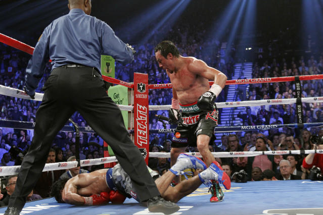 Juan Manuel Marquez (R) of Mexico steps away after knocking out Manny Pacquiao of the Philippines (bottom) in the 6th round during their welterweight fight at the MGM Grand Garden Arena in Las Vegas, Nevada December 8, 2012. REUTERS/Steve Marcus (UNITED STATES - Tags: SPORT BOXING TPX IMAGES OF THE DAY)