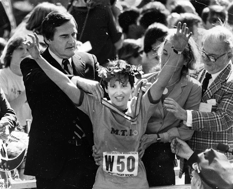 Rosie Ruiz receives a crown after being the first woman to cross the finish line during the 1980 Boston Marathon. (Getty)