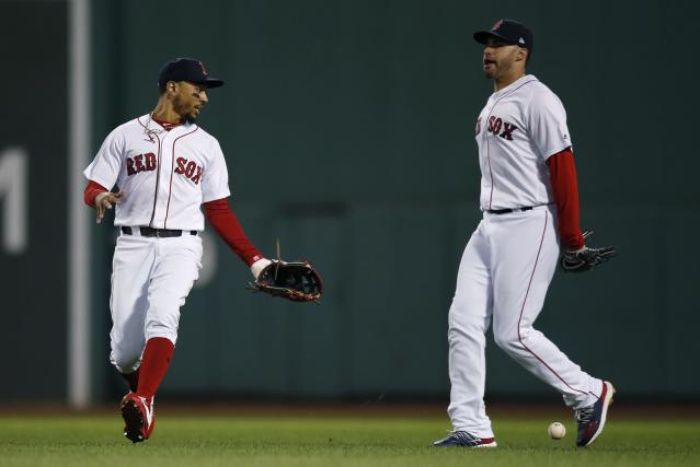 Boston Red Sox's Mookie Betts, left, and J.D. Martinez react after the double by Houston Astros' Alex Bregman dropped between them during the third inning of a baseball game in Boston, Sunday, Sept. 9, 2018. (AP Photo/Michael Dwyer)