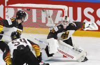 Germany's goaltender Mathias Niederberger follows a puck that missed the goal during the Ice Hockey World Championship group B match between Kazakhstan and Germany at the Arena in Riga, Latvia, Wednesday, May 26, 2021. (AP Photo/Sergei Grits)