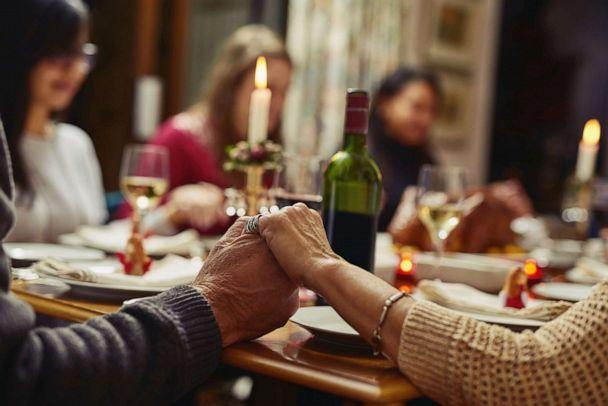PHOTO: Closeup shot of people holding hands before having a meal together (STOCK PHOTO/Getty Images)