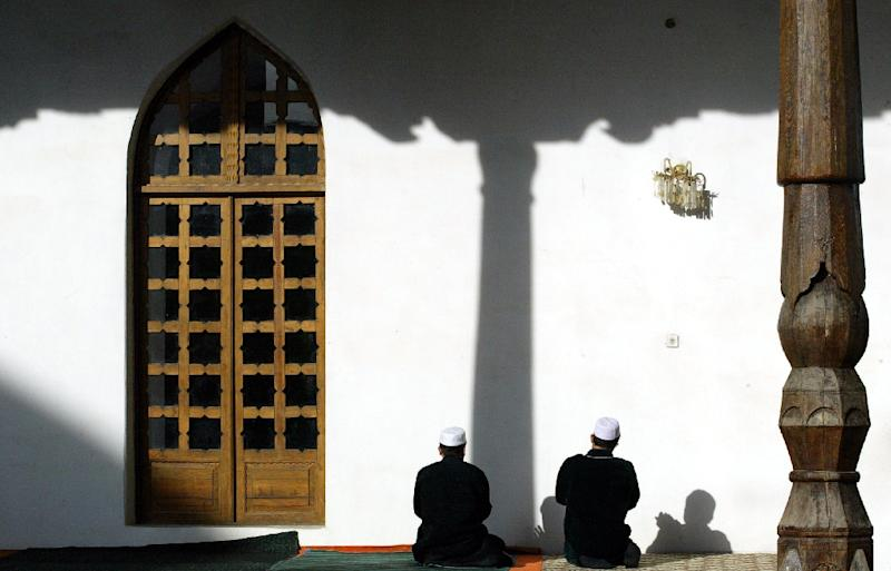 Muslim believers complain repression has grown since controversial parliamentary elections last month handed a landslide victory to the ruling People's Democratic Party of Tajikistan (PDPT) and booted the moderate Islamic opposition out of parliament (AFP Photo/Vyacheslav Oseledko)