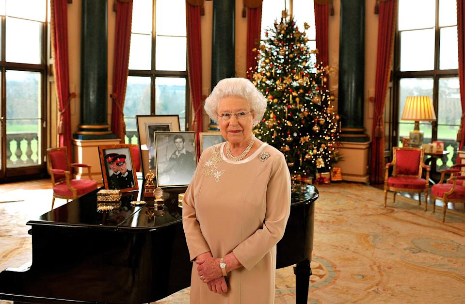 Britain's Queen Elizabeth II stands in the Music Room of Buckingham Palace after recording her Christmas day message to the Commonwealth. PRESS ASSOCIATION Photo. Picture date: Monday December 22, 2008.
