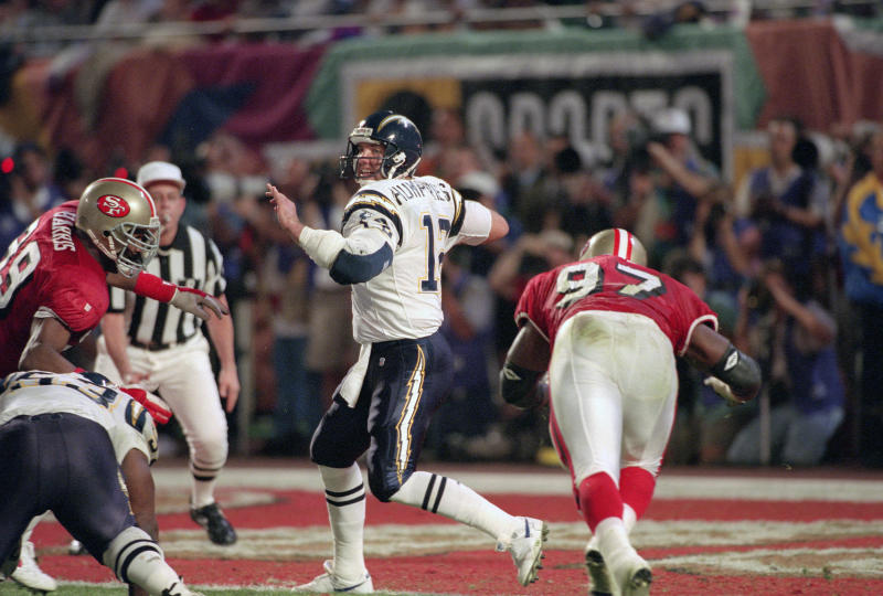 Stan Humphries drops back to pass against the San Francisco 49ers during Super Bowl XXIX on January 29, 1995 in Miami, Florida. The Niners won the Super Bowl 49-26. (Focus on Sport/Getty Images)
