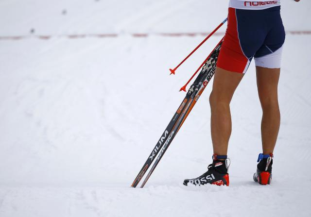 Norway's Jespersen, wearing shorts, stands in the finishing area after competing in the men's 15 km cross-country classic event at the Sochi 2014 Winter Olympic Games in Rosa Khutor