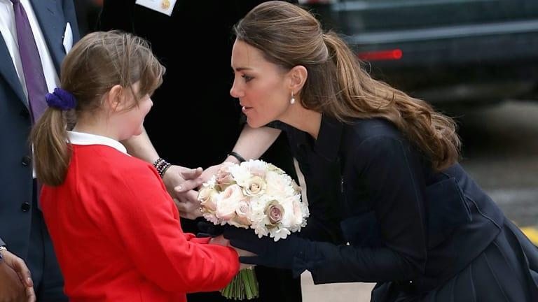 Kate Middleton accepting flowers