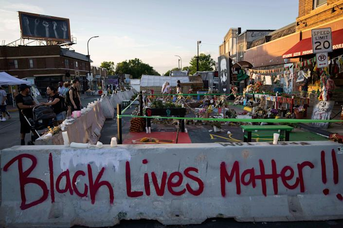 Barriers placed by the city of Minneapolis surround memorials as community members gather in George Floyd Square to protest the death of Winston Smith on June 7. Smith was fatally shot by members of a U.S. marshals task force.