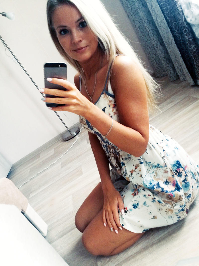 Russian accountant Evgenia Shulyatyeva (pictured in a selfie here) was killed after she was electrocuted by a charging phone that is believed to have fallen in the bath.