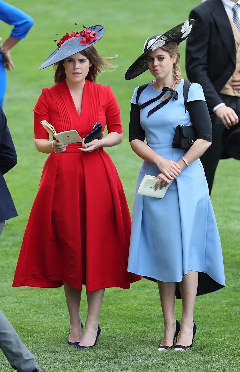 <p>The princesses returned on the third day of Ascot, along with their aunt, grandmother and cousin Zara. The duo looked lovely in red and pale blue.<br><em>[Photo: PA]</em> </p>