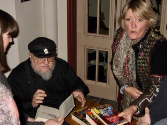Johnson and GRRM at a book signing: the series has now sold 90 million copies worldwide (Jane Johnson)