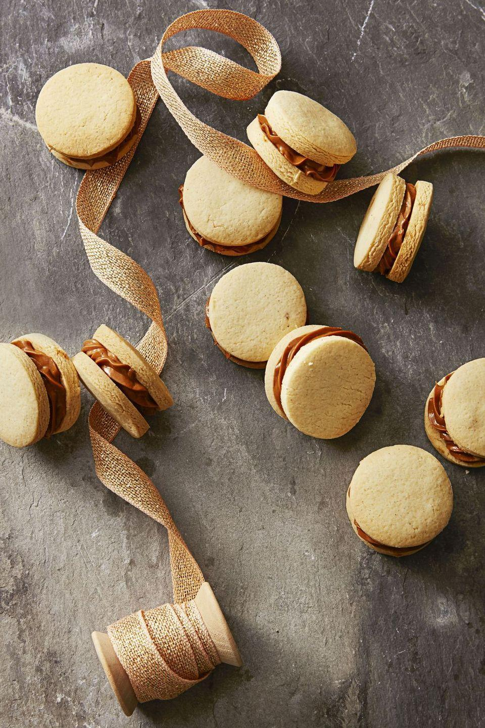 "<p>Don't forget dessert! With a creamy caramel filling, these cookies certainly aren't your average sandwich.</p><p><em><a href=""https://www.goodhousekeeping.com/food-recipes/dessert/a35757/dulce-de-leche-sandwiches/"" rel=""nofollow noopener"" target=""_blank"" data-ylk=""slk:Get the recipe for Dulce De Leche Sandwiches »"" class=""link rapid-noclick-resp"">Get the recipe for Dulce De Leche Sandwiches »</a></em></p>"