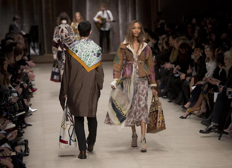 Model Jourdan Dunn wears a design created by Burberry Prorsum Womenswear during London Fashion Week Autumn/Winter 2014, at Perks Field, Kensington Palace, in Hyde Park, central London, Monday, Feb. 17, 2014. (Photo by Joel Ryan/Invision/AP)