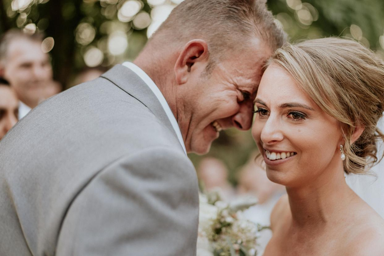 """A close-up of the bride and groom's smiling faces, their foreheads touching. The groom is in profile, with the bride angled toward the camera. (Photo: <a href=""""https://www.jamesday.com.au/"""" rel=""""nofollow noopener"""" target=""""_blank"""" data-ylk=""""slk:James Day Photography"""" class=""""link rapid-noclick-resp"""">James Day Photography</a>)"""