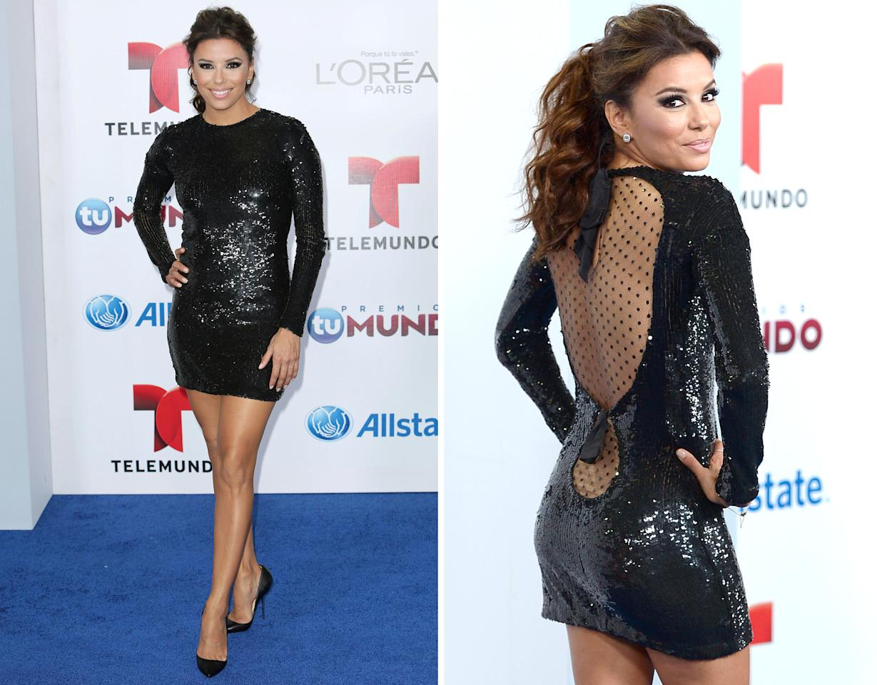 "<b>Eva Longoria</b>, 38, stole the spotlight upon arriving at Telemundo's Premios Tu Mundo Awards in Miami Thursday evening. A sequined Emilio Pucci mini and sky-high Louboutin pumps allowed the former ""Desperate Housewives"" star to shimmer while showcasing her signature stems. But, Longoria's legs weren't the only parts of her body on display. The sexy frock also featured a sheer back panel that highlighted her pert posterior. Va-va-voom!"