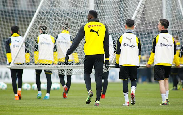 Soccer Football - Usain Bolt participates in a training session with Borussia Dortmund - Strobelallee Training Centre, Dortmund, Germany - March 23, 2018 Usain Bolt helps move a goal during Borussia Dortmund training REUTERS/Thilo Schmuelgen