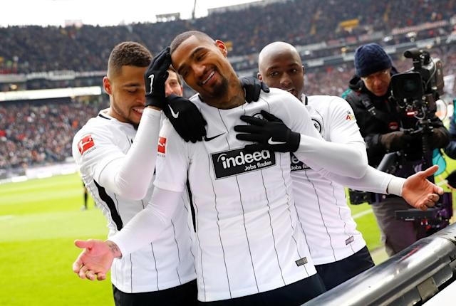Soccer Football - Bundesliga - Eintracht Frankfurt vs 1.FSV Mainz 05 - Commerzbank-Arena, Frankfurt, Germany - March 17, 2018 Eintracht Frankfurt's Kevin-Prince Boateng celebrates scoring their first goal with teammates REUTERS/Kai Pfaffenbach DFL RULES TO LIMIT THE ONLINE USAGE DURING MATCH TIME TO 15 PICTURES PER GAME. IMAGE SEQUENCES TO SIMULATE VIDEO IS NOT ALLOWED AT ANY TIME. FOR FURTHER QUERIES PLEASE CONTACT DFL DIRECTLY AT + 49 69 650050 TPX IMAGES OF THE DAY