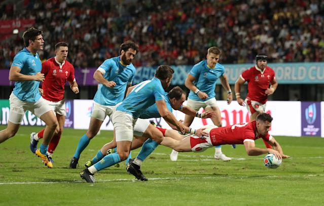 Tomos Williams scores Wales' fourth try. (Photo by Shaun Botterill/Getty Images)