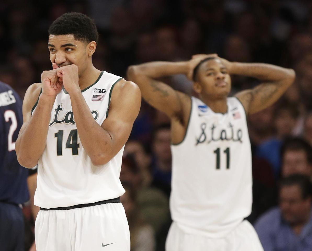 Michigan State's Gary Harris and Keith Appling react in the second half of a regional final against Connecticut at the NCAA college basketball tournament on Sunday, March 30, 2014, in New York. (AP Photo/Seth Wenig)
