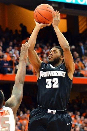 Providence's Vincent Council shoots over Syracuse's Rakeem Christmas during the first half in an NCAA college basketball game in Syracuse, N.Y., Wednesday, Feb. 20, 2013. (AP Photo/Kevin Rivoli)