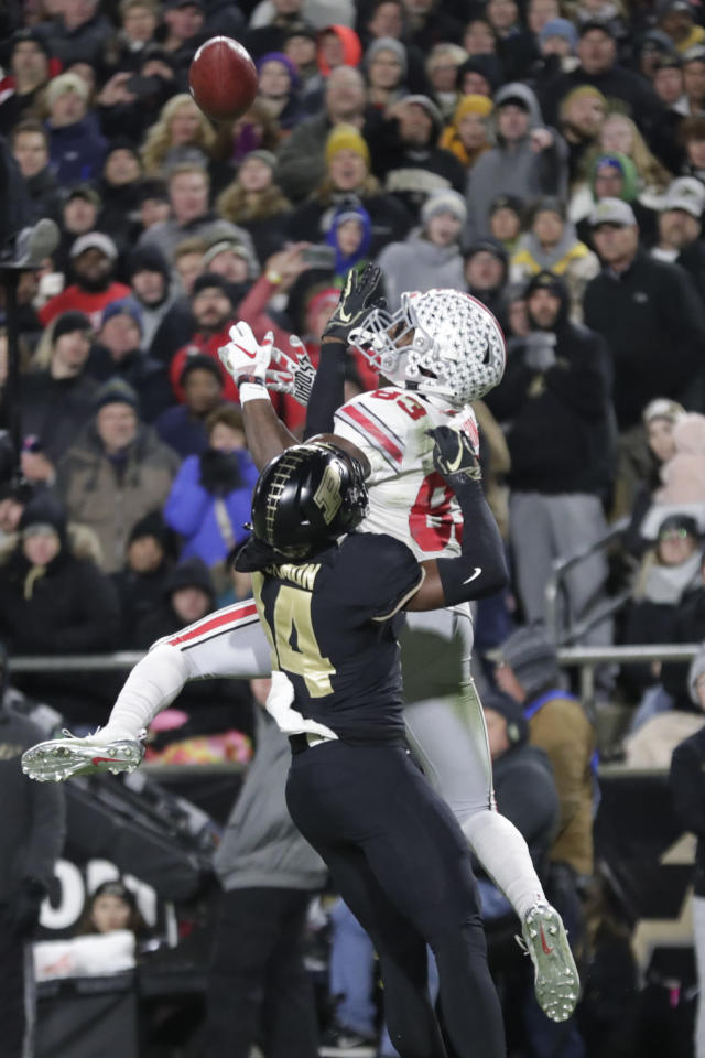Purdue cornerback Antonio Blackmon (14) breaks up a pass to Ohio State wide receiver Terry McLaurin (83) during the first half of an NCAA college football game in West Lafayette, Ind., Saturday, Oct. 20, 2018. (AP Photo/Michael Conroy)