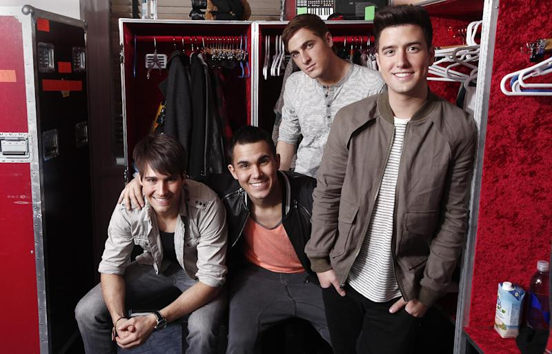 "FILE - In this March 9, 2012 file image, the boy band Big Time Rush, from left, James Maslow, Carlos Pena Jr., Kendall Schmidt and Logan Henderson, pose for a portrait in their dressing room at Radio City Music Hall in New York. Big Time Rush says they want to do more than play music in support of Michelle Obama's healthy living campaign_ they want to be her ""fit representatives of America.""  Band member Logan Henderson says ""it's a huge part of our lifestyle, so to get other kids involved and get them aware, about being healthy and exercising, is exactly what we want to do.""  The group performed a few songs including their new single ""Windows Down"" for winners of Mrs. Obama's healthy lunch recipe contest at the first Kids' State Dinner luncheon held at the White House on Monday, Aug. 20.  (AP Photo/Carlo Allegri, file)"