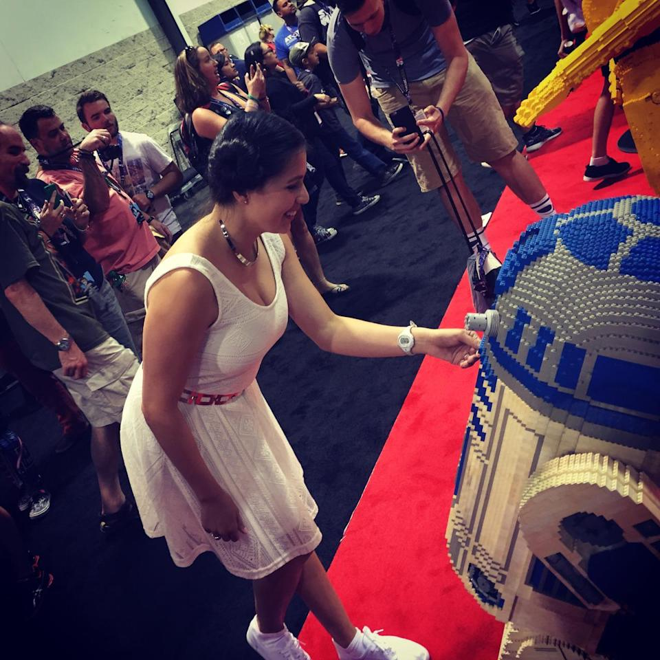 Cosplaying Leia inserting Death Star plans on R2-D2. Hope she realizes that's just a Lego droid and all those Bothan spies didn't die for naught.
