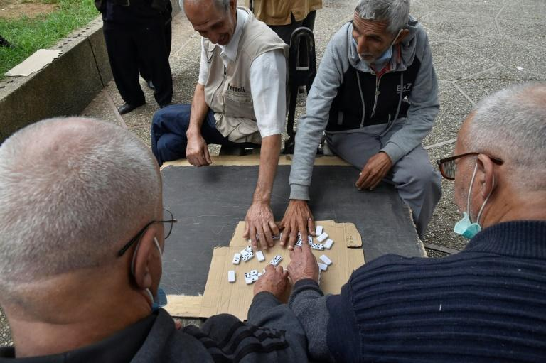 Retired Algerians play chess in a park in Bab El-Oued, a stronghold of the Hirak protest movement, as the country prepares to vote on constitutional changes