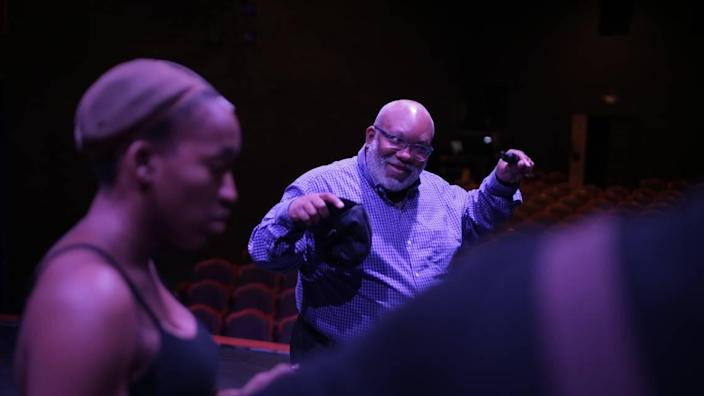 """In this 2019 photo, Corey Mitchell offers guidance during a rehearsal for Theatre Charlotte's """"Ain't Misbehavin,'"""" which he directed."""