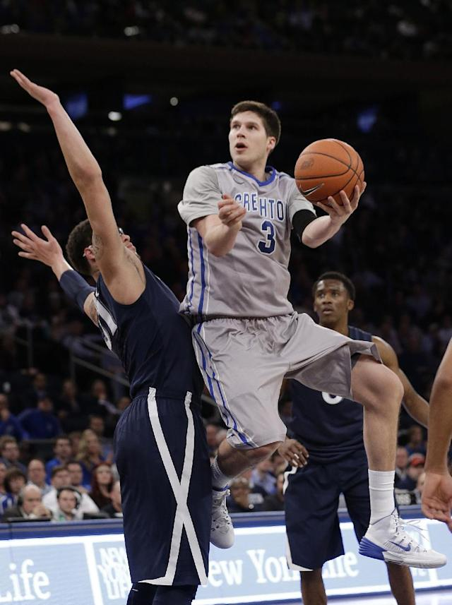 Creighton's Doug McDermott (3) drives past Xavier's Isaiah Philmore during the first half of an NCAA college basketball game in the semifinals of the Big East Conference tournament Friday, March 14, 2014, at Madison Square Garden in New York. (AP Photo/Frank Franklin II)