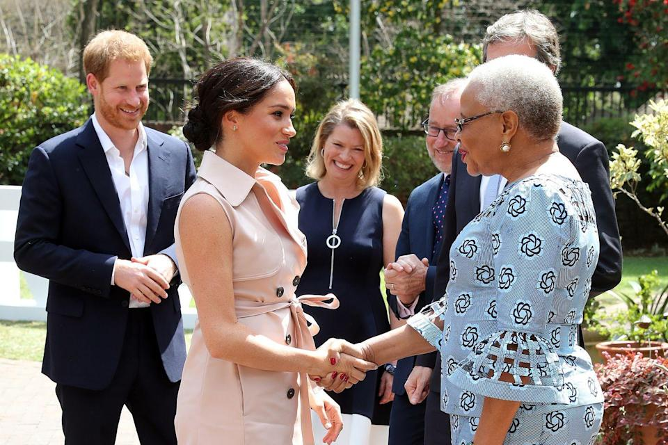 <p>Meghan meets Graça Machel, widow of the late Nelson Mandela, in Johannesburg, South Africa.</p>