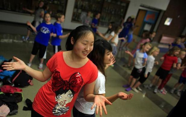 Amy Wang, a foreign exchange student from Shenyang, China, and Tina Chuang from Pingtung, Taiwan teach choreography to elementary students after hours at Grant-Deuel School in Revillo, South Dakota February 13, 2012.