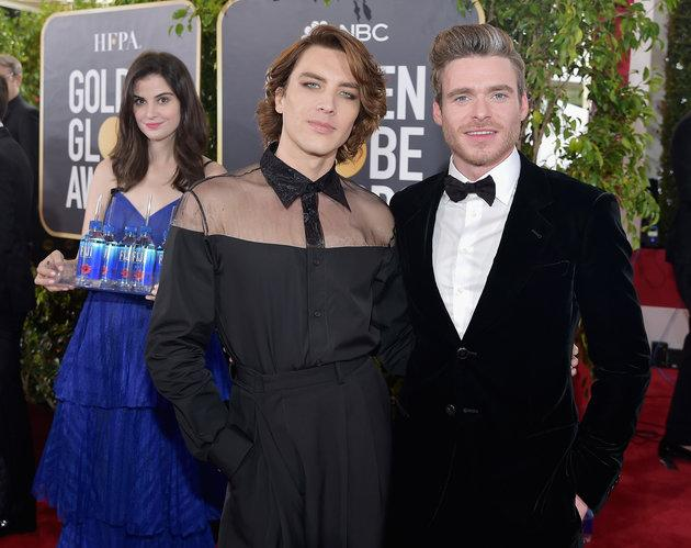 Kelleth in the background of Cody Fern and Richard Madden's photo