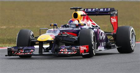 Red Bull Formula One driver Sebastian Vettel of Germany competes during the qualifying session for the Korean F1 Grand Prix at the Korea International Circuit in Yeongam, October 5, 2013. REUTERS/Kim Hong-Ji