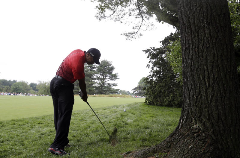 Tiger Woods hits down the second hole during the fourth round of the U.S. Open golf tournament at Merion Golf Club, Sunday, June 16, 2013, in Ardmore, Pa. (AP Photo/Gene J. Puskar)