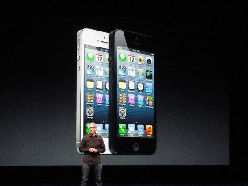 Apple's CEO Tim Cook presents the new iPhone 5