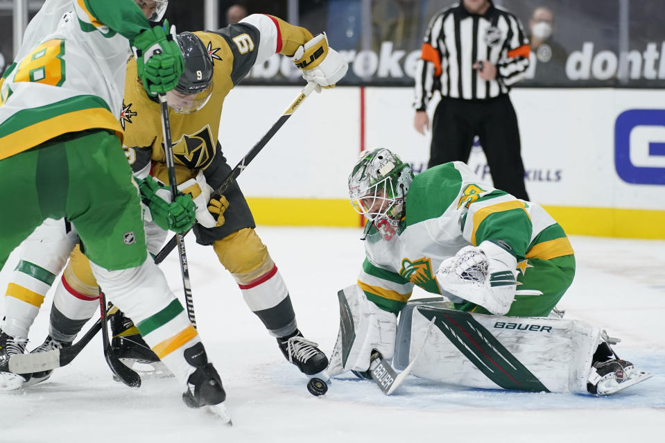 Minnesota Wild goaltender Cam Talbot (33) stops an attempted shot by Vegas Golden Knights center Cody Glass (9) during the second period of an NHL hockey game Wednesday, March 3, 2021, in Las Vegas. (AP Photo/John Locher)