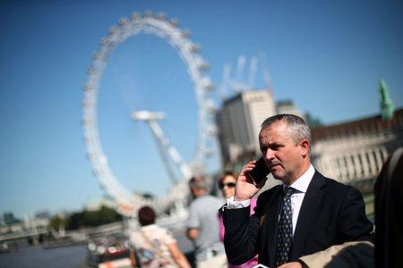 A businessman talks on his mobile phone on Westminster Bridge in central London