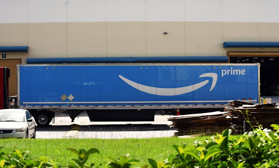 An Amazon Prime truck is seen at a distribution center on July 14, 2019 in Orlando, Florida. On July 15 and 16, 2019, Amazon holds its annual Amazon Prime Day, a 48-hour event during which Prime members can shop online for hundreds of thousands of specially discounted items.  (Photo by Paul Hennessy/NurPhoto via Getty Images)