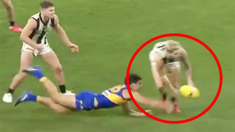 A screenshot shows the moment Jack Crisp appeared to throw the ball to teammate Scott Pendlebury.