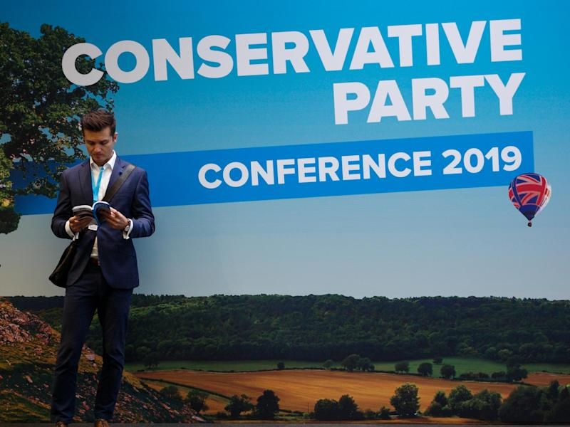 A visitor to conference takes a break during the second day of the Conservative Party Conference: Getty Images